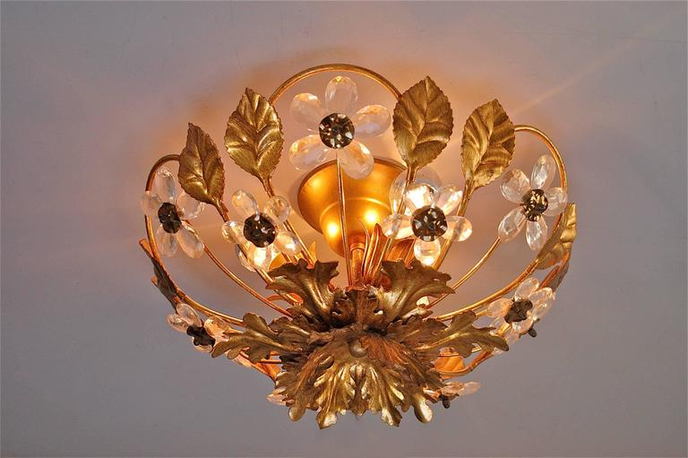 Gold metal floral flush mount ceiling light with crystal flowers this gold coloured metal floral ceiling light shaped like a basket is decorated with aloadofball Gallery