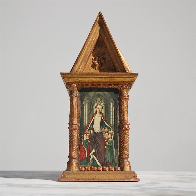 A rare, neo-gothic miniature replica of the Sint Ursula shrine by Hans Memling, made by an unknown craftsman in the middle of the 20th century. The main body is constructed from solid wood and ornately decorated with pillars, rosettes and other
