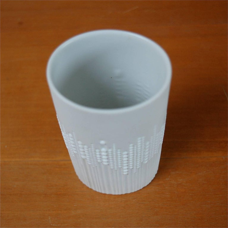 Porcelain pearl drops vase in mint condition designed by Tapio Wirkkala for the Rosenthal Factory based in Germany. The oval shaped vase has a matt white finish. The outer surface consists of carved vertical lines decorated with small round raised