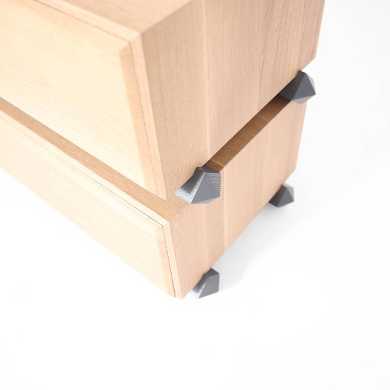 Using the simple gesture of stacking volumes, this easily customized storage collection creates sculptural and functional containers of space. Solid wood construction thoughtfully handcrafted in the USA.