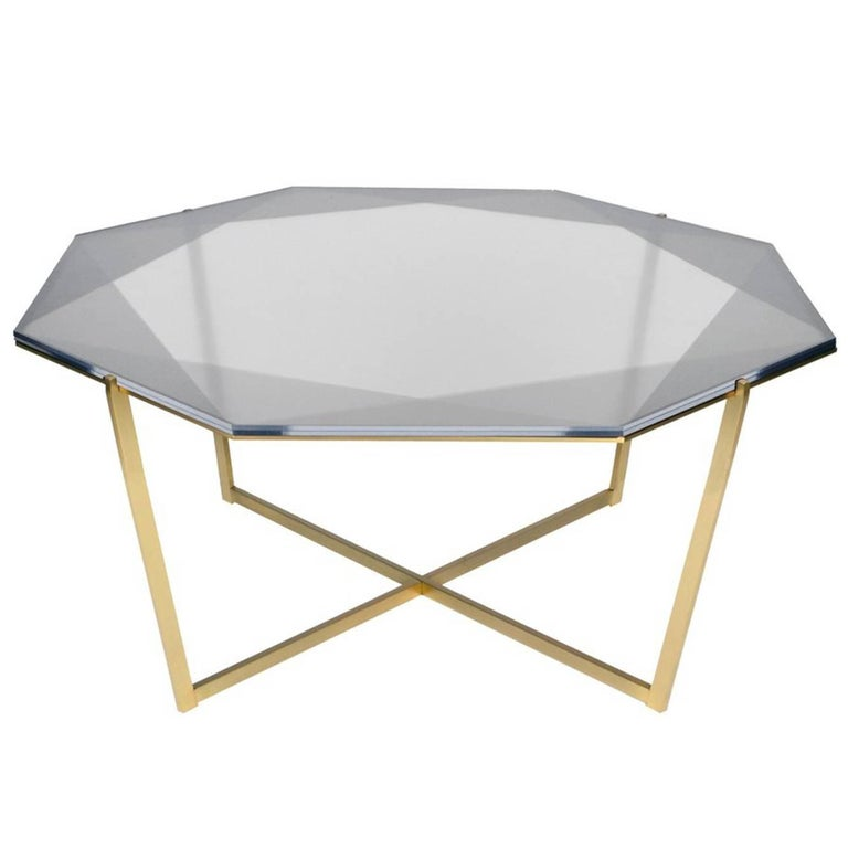 Our Gem collection of tables are inspired by the reflections of light and transparencies found in gemstones. These metal and glass tables translate facets through layers of color and varying opacity. Each table base is designed as a setting with