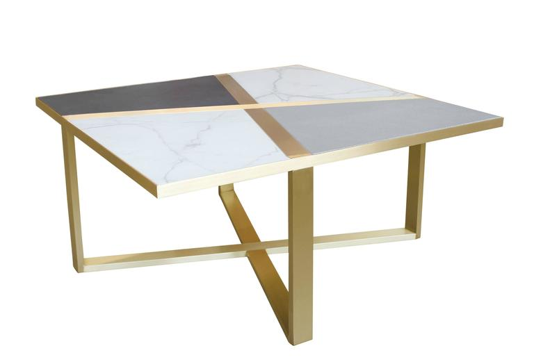 Bronze frame cocktail table with inset marble and leather panels. Available in custom sizes, finishes, materials, as well as COL. Each piece is made to order and be specified in any combination of material palettes.