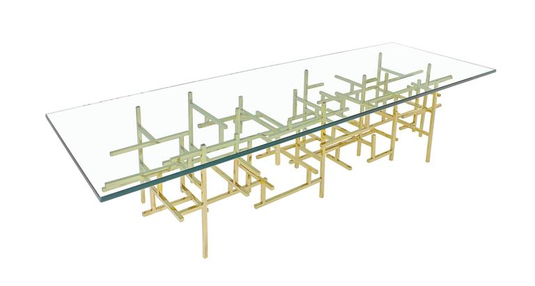 James Devlin Studio's Maya Cocktail table is a tour de force of meticulous hand craftsmanship. Dozens of hand cut and welded brass rods create unique compositions of unsurpassed modernism. No two pieces are the same. Each Maya Table offers a