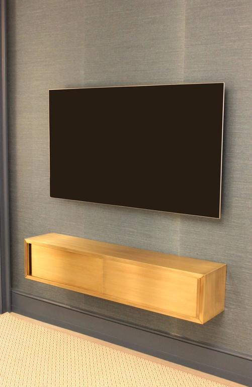 Modern Wall-Mounted Media Console in Patinated Bronze with Sliding Doors For Sale