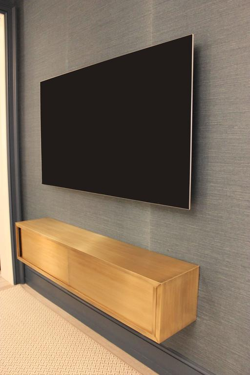 American Wall-Mounted Media Console in Patinated Bronze with Sliding Doors For Sale