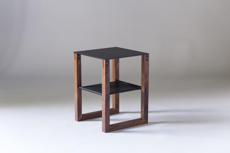 The Sling - Modern Aluminum, Leather and Walnut Side Table   Minimal and elegant form paired with a balanced and thoughtful design. The Sling side table features powder-coated aluminum, blackened hand-stitched leather, and hand finished walnut.