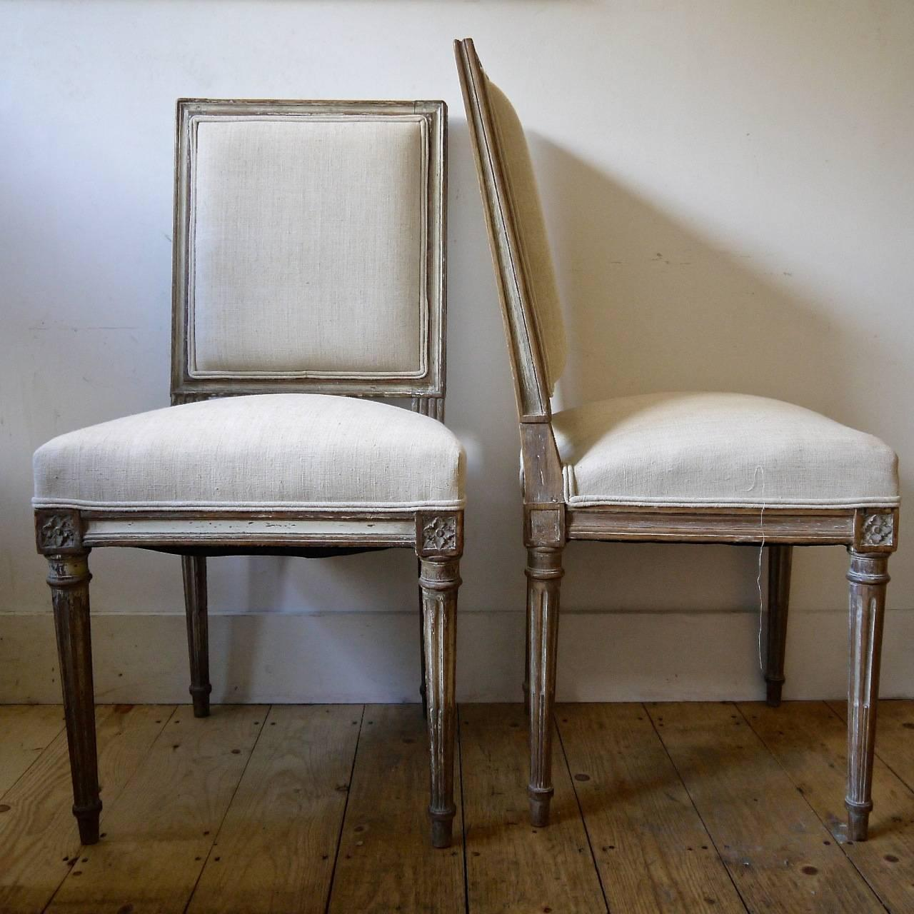 19th century painted dining room chairs upholstered in antique linen