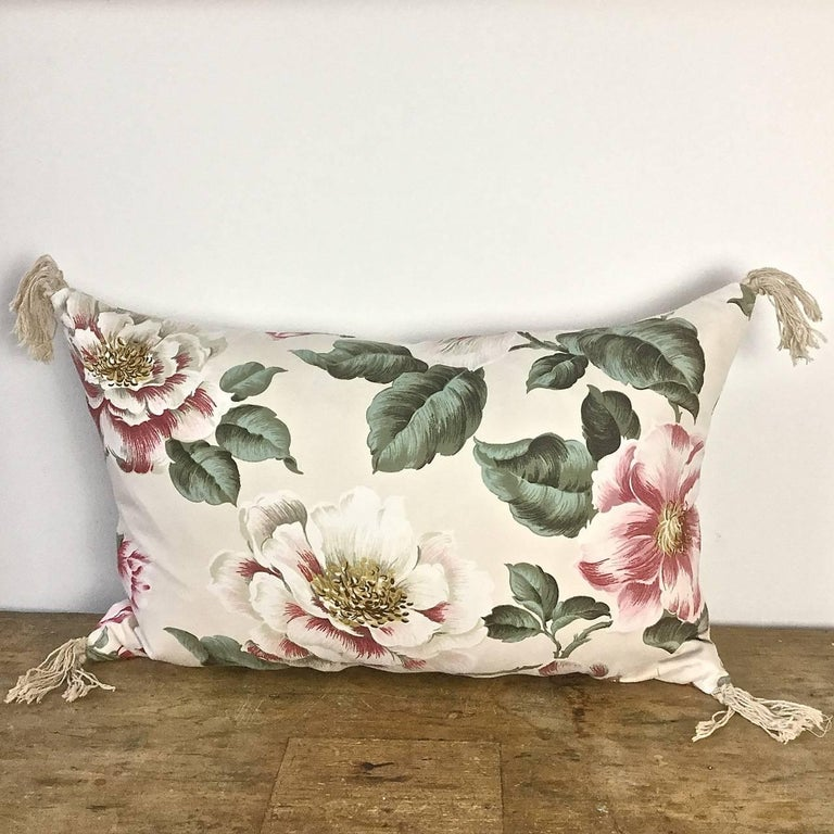 English large-scale print of magnolia flowers and leaves on a soft cotton, circa 1950s. The same print is on the reverse of the cushion which has vintage cotton tassels on each corner. Slip-stitched closed with a duck feather insert.