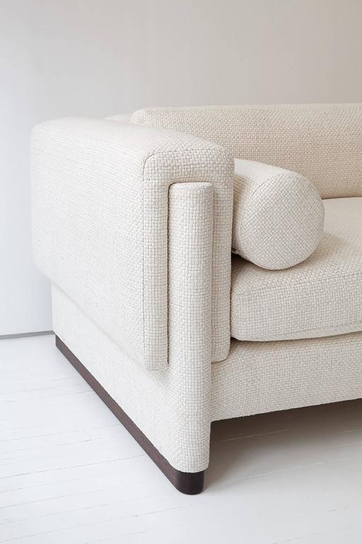 The Howard Sofa is a deco inspired contemporary piece. Constructed using 8-way hand tied springs in collaboration with our team of highly skilled local fabricators, it is available on a made to order basis in the fabric as shown or in COM. Priced as