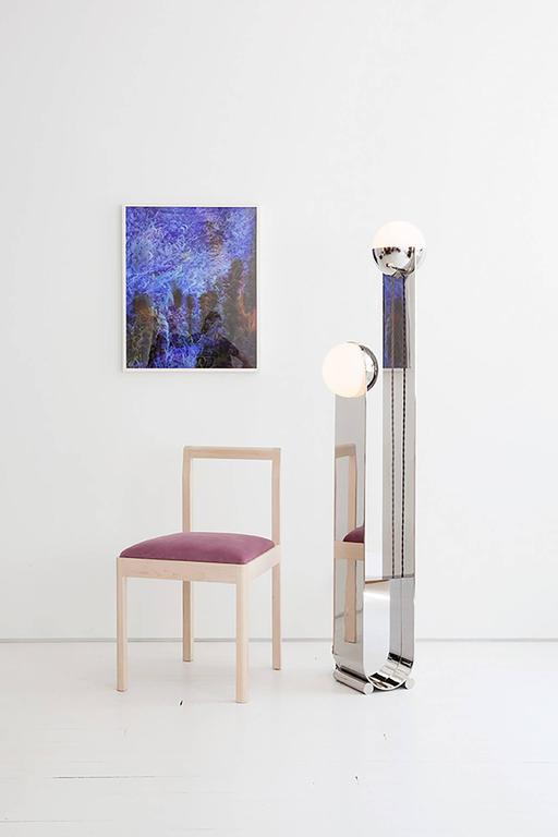 The Pete & Nora Floor Lamp is crafted in collaboration with our team of highly skilled local fabricators, and is available in polished stainless steel and handblown glass. The glass globes unscrew to allow access to the sockets, which are