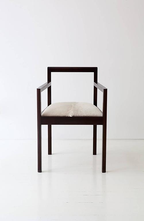 The Densen Arm Chair is handcrafted in our Brooklyn studio and in collaboration with our team of highly skilled local fabricators. It is constructed of solid wood and upholstered in COM. Shown above in walnut.