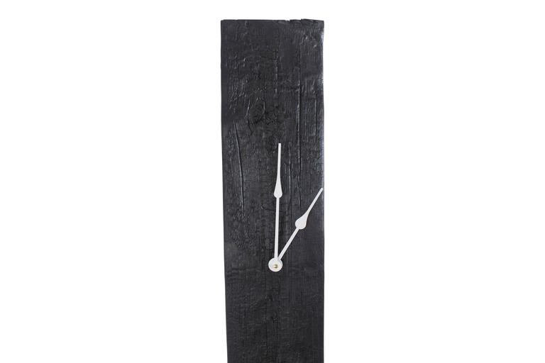 A sleek modern take on the grandfather clock. This piece is made from historic decommissioned NYC water tower wood. The wood is torched in the Shou Sugi Ban method and then sealed with oil to achieve its beautiful color and texture. The high-torque