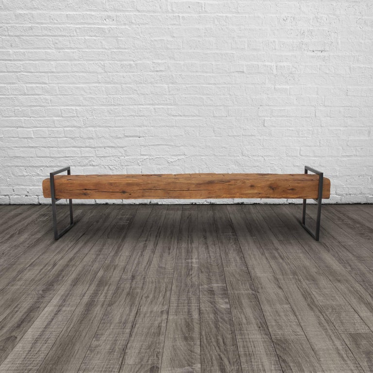 This modern Minimalist bench is constructed from two structural oak beams that appear to float upon a welded steel frame. These historic beams were salvaged from a Bed-Stuy brownstone during demolition, likely dating from the 1860's the character of