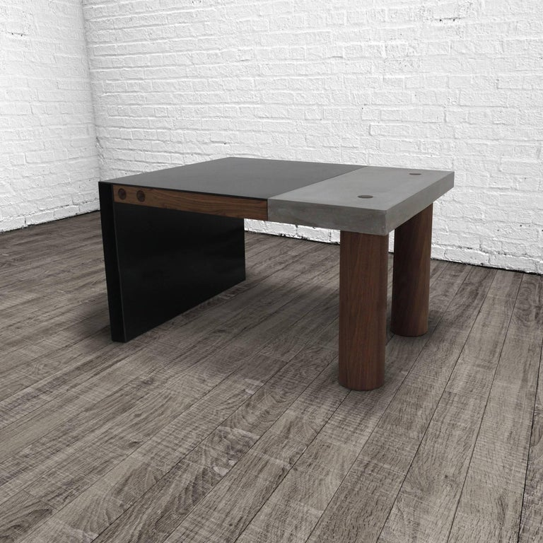 The paradigm desk seamlessly integrates three elemental materials, concrete, steel and wood. The combination of cast concrete with hand-turned walnut legs and thru-tenon joinery married to hand-blackened steel with an oil and wax finish make for a