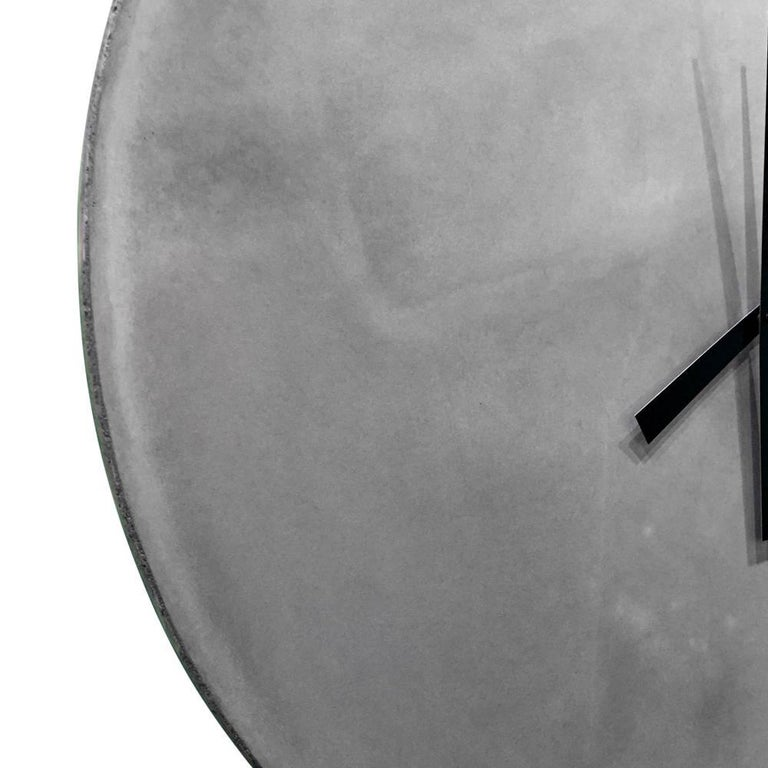 This impressive clock is made from cast-concrete. The high-torque clock motor runs on a single AA battery and adjusts automatically to daylight savings time in the US.  This is a bespoke piece so custom dimensions, materials, colors and finishes