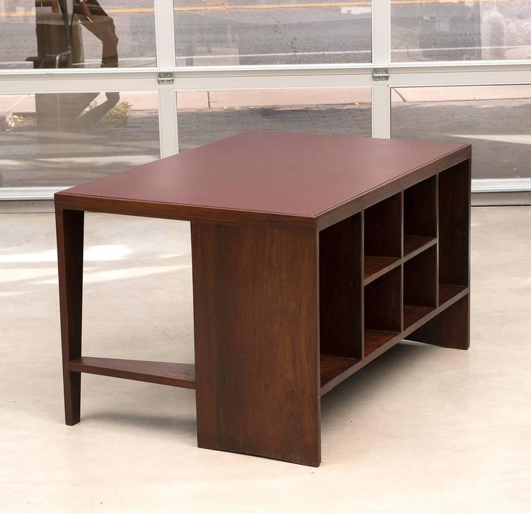 Indian rosewood desk with red leather top by Pierre Jeanneret from Chandigarh, 1950s.  Available as a set with a Pierre Jeanneret library chair.  Please inquire.