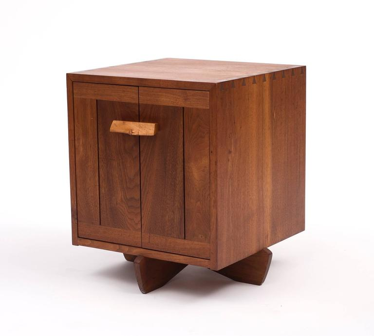 A stunning Kornblut case by George Nakashima in black walnut and maple burl, 1970s.  Piece comes with a document of authentication by Mira Nakashima.