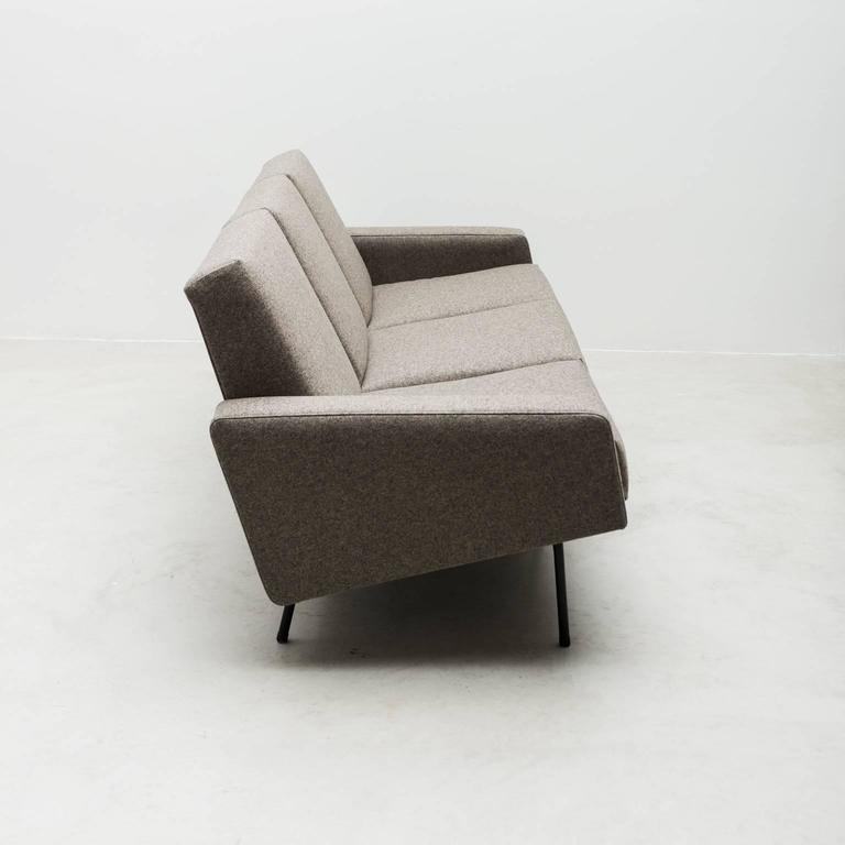 A three-seat sofa by Pierre Guariche for Airborne. Frame in black enameled steel. Newly restored in a taupe grey Danish wool by Kvadrat, France, 1950s.