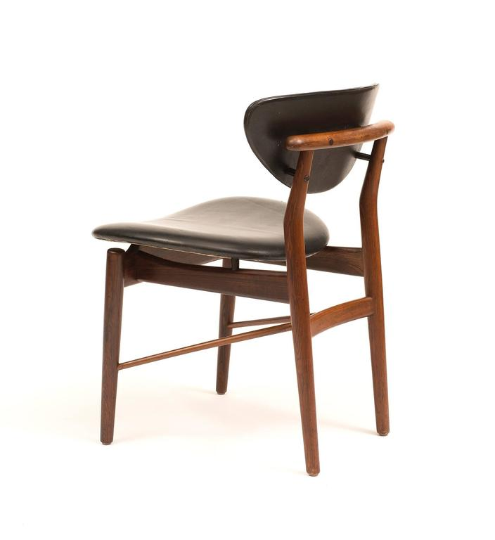 set of four finn juhl nv55 dining chairs in rosewood and
