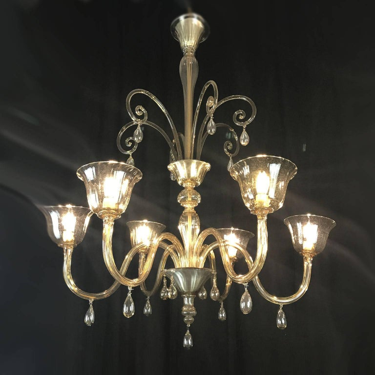 1920s Venetian Murano smoked blown glass six-light chandelier, an antique Deco blown glass pendant, a timeless fumè chandelier with extremely essential and elegant structure. The stem that supports the chandelier consists of many sections, different