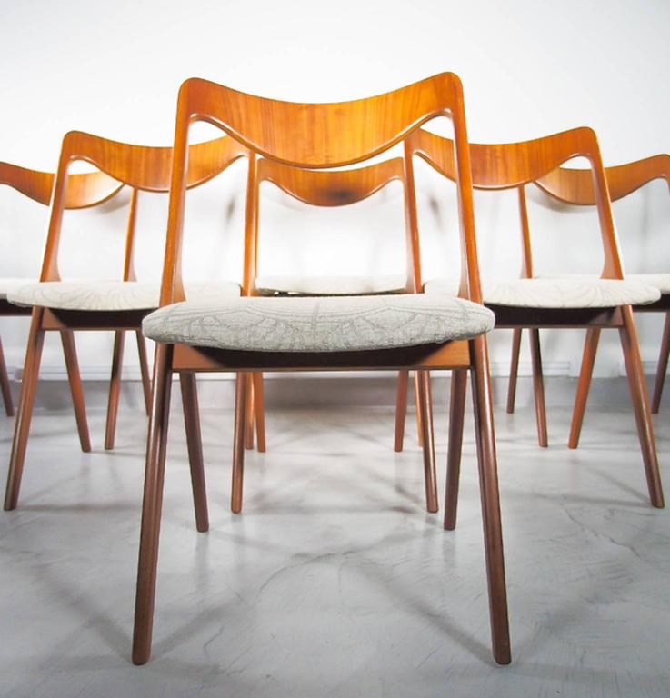 Set of four teak dining chairs with curved backrest, manufactured in Sweden by Albin Johansson & Sons. Padded seats covered in grey/beige linen patterned fabric. Excellent condition.