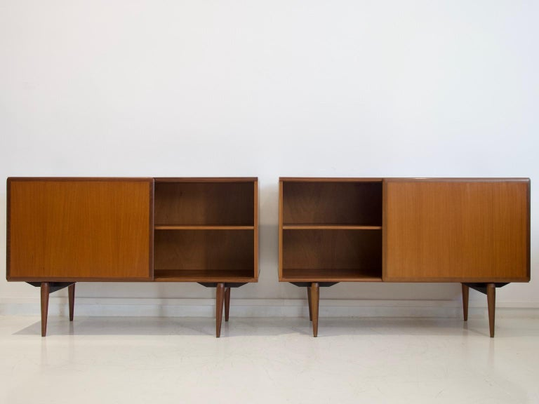 Pair of teak sideboards with sliding doors and drawers. Manufactured in Italy by Amma in the 1950s. The surface of these credenzas has been restored; overall great vintage condition.