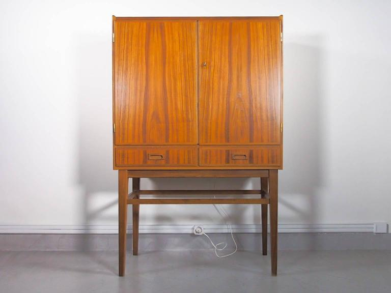 Veneer Mid-20th Century Bar Cabinet with Interior Mirrors and Light For Sale