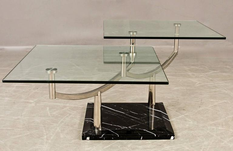 Elegant And Functional Two Level Glass Coffee Table With Rectangular Glass  Panels On Chrome Pedestal