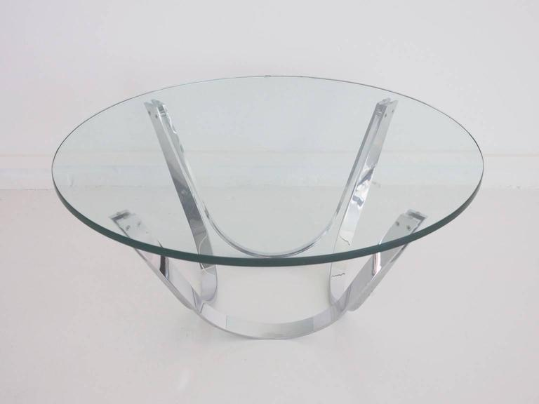 Round coffee table from the 1970s. Produced by Tri-Mark Designs, USA. Chromed flattened steel frame and loose 2 cm thick crystal tabletop.