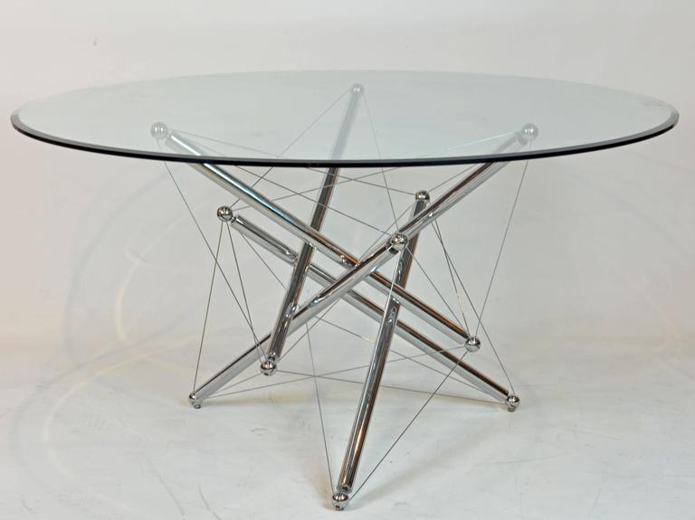 A beveled 0.5 in. crystal glass circular top resting on an intricately constructed base of chromium-plated steel tubes, spheres and cables designed to a configuration of ever changing visual properties. Manufactured by Cassina, Italy in the 1970s
