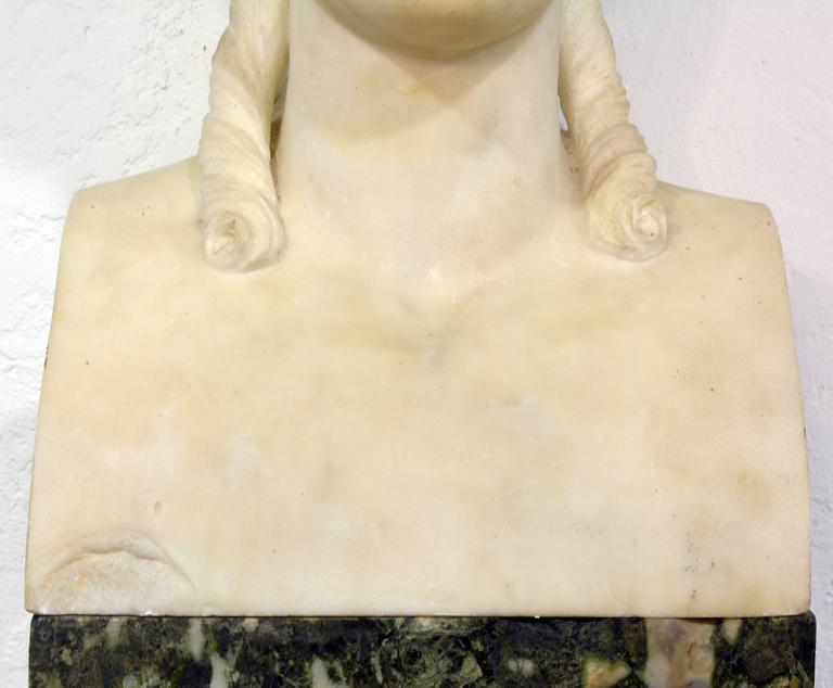 Standing 84 inches tall the marble bust of the Greek goddess Nike (Roman: Victoria), goddess of victory, is placed upon a tall square column of Italian back and white marble terminating in a carrara marble molded base.