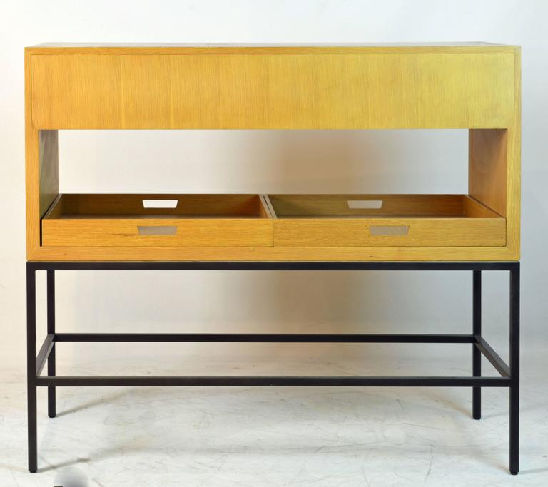 Great Minimalist design by Vanderbyl, one of the leading designers of today. The piece features two drawers, pull outs in both ends and two removable trays all resting on a lacquered four leg steel frame. The quality of the malerials and