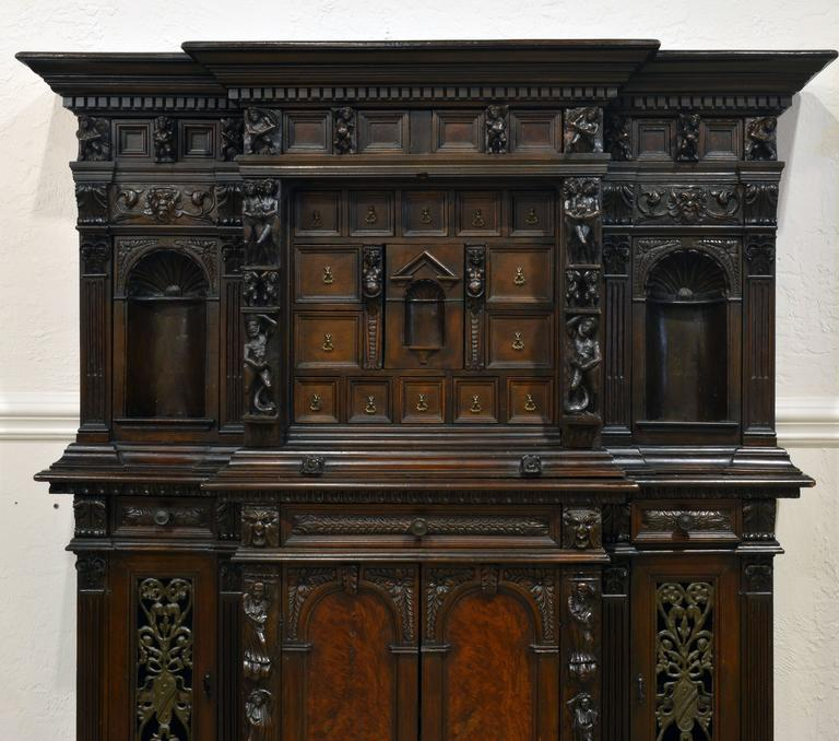 This palatial type of furniture originates in Genoa during the Renaissance in the 16th century. Originally a figurally carved fall front writing cabinet called a Stipo a bambocci, the bambocci being the high relief carved religious and secular
