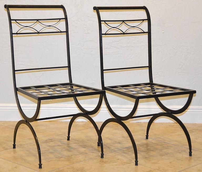 Set of eight French wrought iron chairs, circa 1920s Empire style. Great condition.