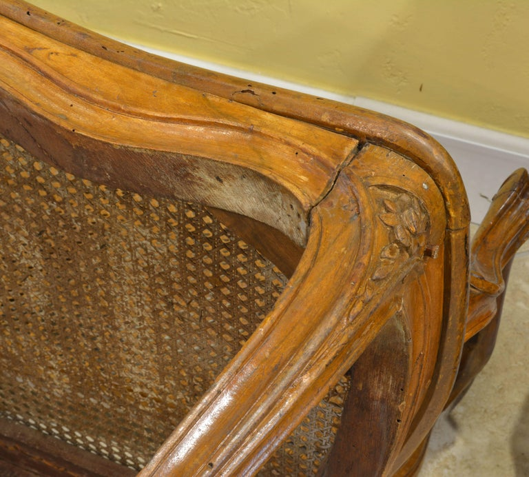 French Late 18th Century Provincial Louis XV Style Carved and Caned Walnut Settee For Sale