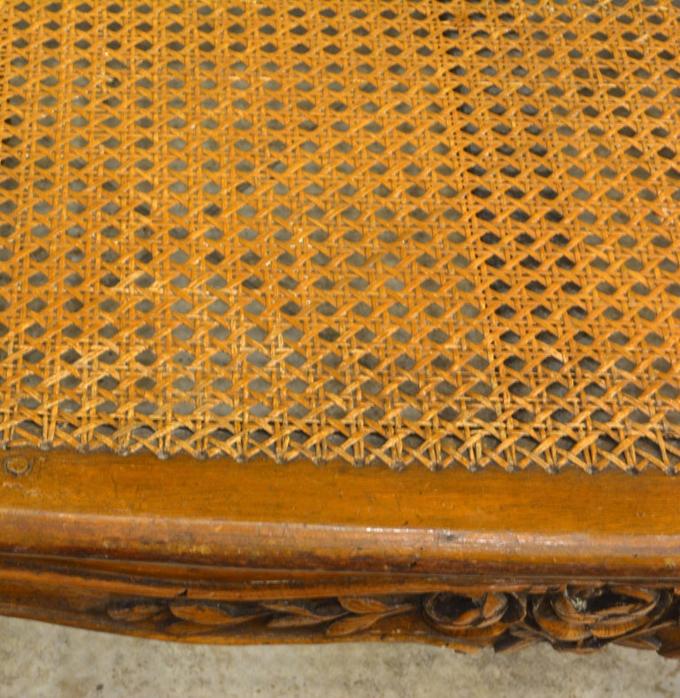 Late 18th Century Provincial Louis XV Style Carved and Caned Walnut Settee For Sale 1