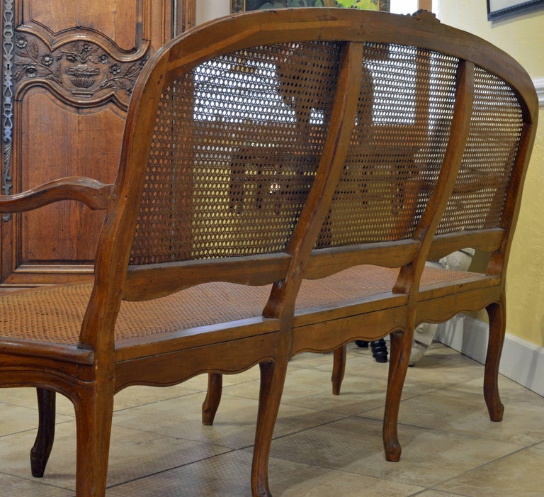 Late 18th Century Provincial Louis XV Style Carved and Caned Walnut Settee For Sale 2