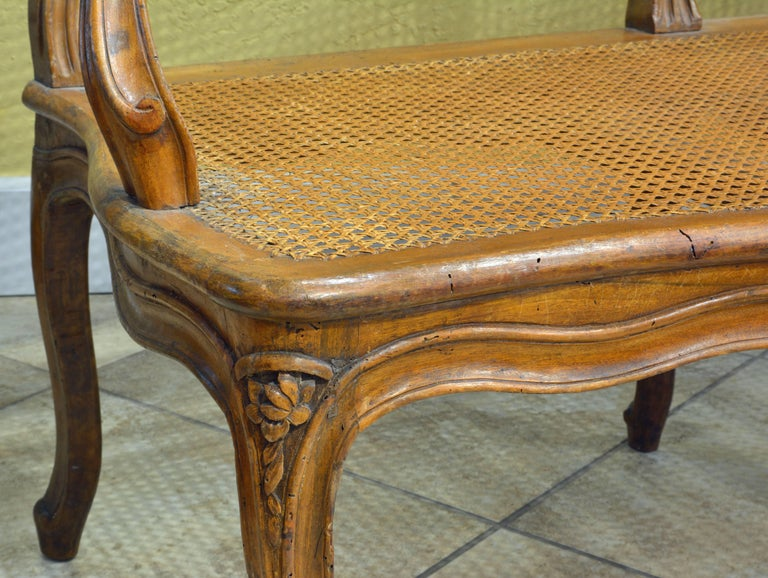 French Provincial Late 18th Century Provincial Louis XV Style Carved and Caned Walnut Settee For Sale