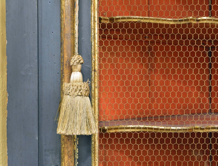 Metal Charming 18th Century Italian Late Baroque Paint & Gilt Mesh Door Corner Cabinet For Sale