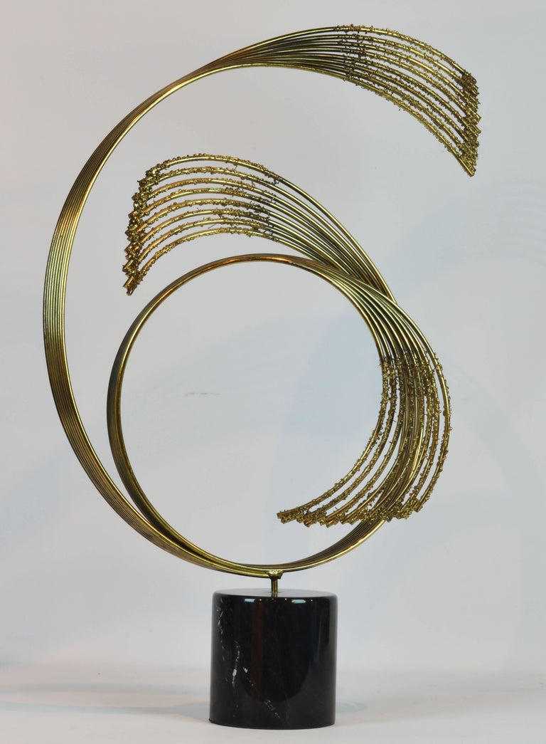 Standing 33 inches tall on its marble base this sculpture offers ever changing views and subtle contrasts. It can be rotated freely in its base.   Curtis Jere is a compound nom-de-plume of artists Curtis Freiler and Jerry Fels. The two founders