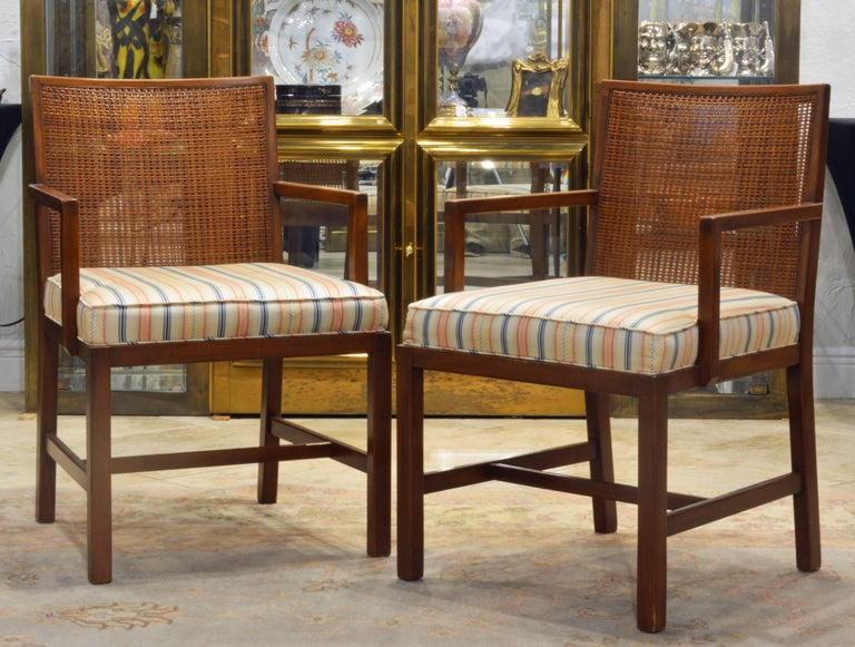 These Mid-Century Modern chairs feature elegant design and classic modern form that will always be synonymous with good taste. The combination of a sturdy but minimalist frames, cane backs and upholstered seats is very comfortable. The measurements