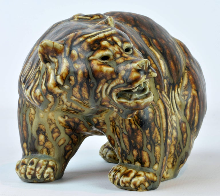 A beautiful and impressive sung glazed stoneware sculpture by Knud Kyhn for Royal Copenhagen. Factory 1st. Royal Copenhagen marks and incised artist's signature under paws, see photos. L 9 in. D 6.75 in. H 5.75 in. Flawless condition.