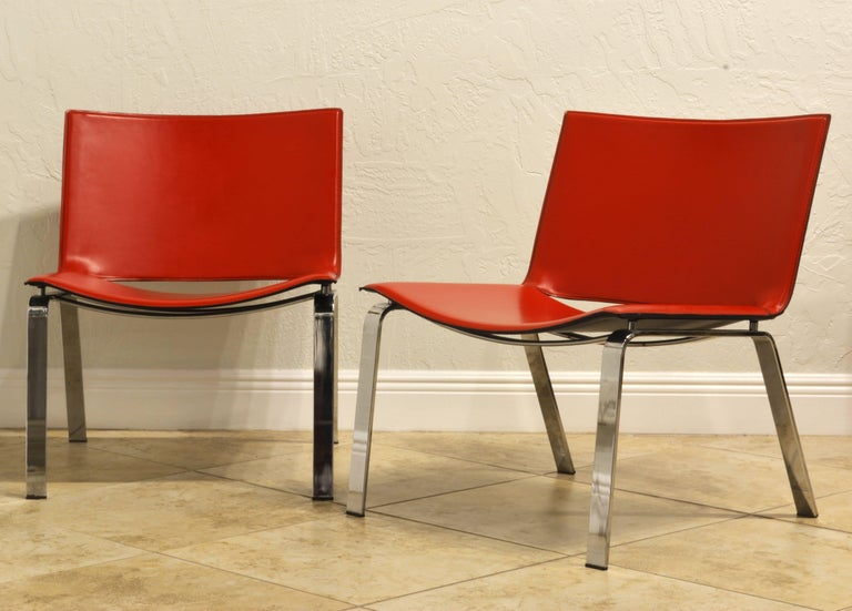 Exceptionally well designed these vintage red leather chairs by legendary Cattelan collection in Italy are very comfortable and strikingly elegant.
