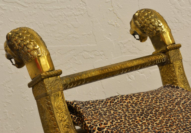 20th Century Anglo-Indian Brass Repousse Clad Lion's Head and Paw Feet Curule Bench or Stool For Sale