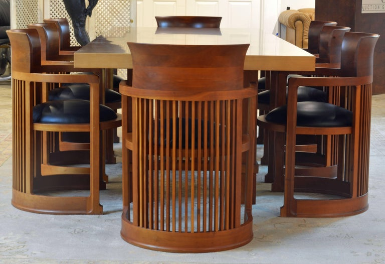This group of Frank Lloyd Wright Taliesin inspired dining table and chairs are made in Italy and features high quality of craftsmanship and materials. Measurements: The table is 98.5 inches long, 38.5 inches wide and 29 inches high. The chairs are