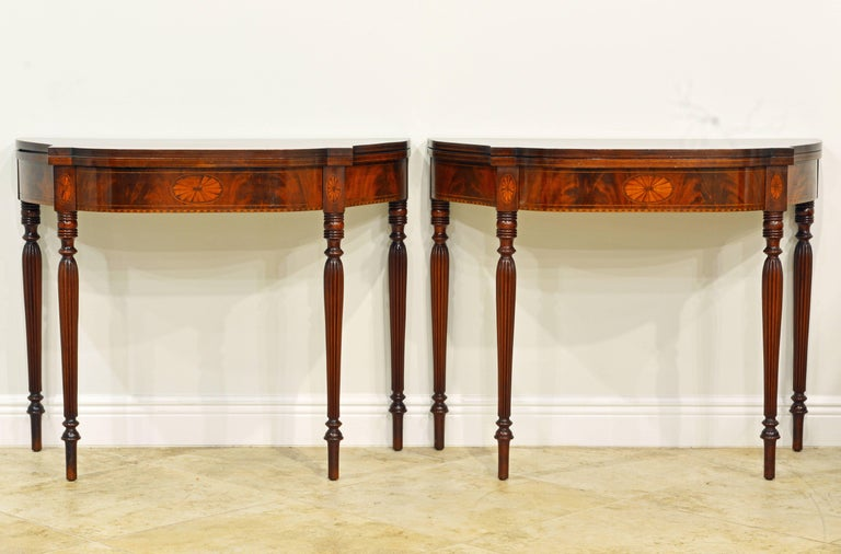 This fine and elegant pair of Sheraton style card tables feature shaped polished mahogany tops that with a swing out leg open up to a full size table. They are also very decorative with the leaf opened up against a wall, see photos. The sunburst