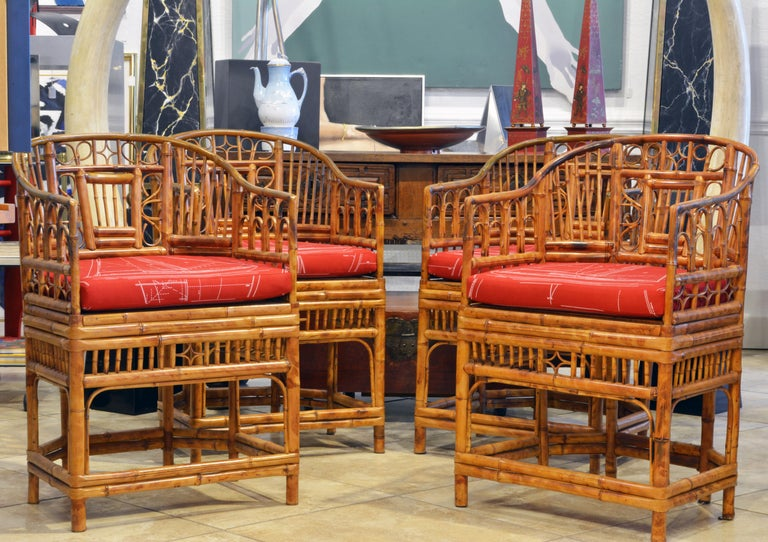 Rising on six legs these intricately crafted iconic armchairs with cane seats feature bamboo frames and Chinese themed bamboo open work inspired by Chippendale design. They come with new cushions covered with Ralph Lauren Voyager fabric in mint