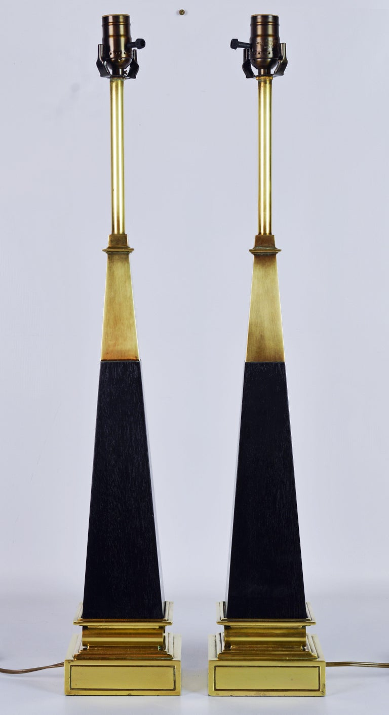 Mid-Century Modern Pair of Brass and Ebonized Wood Obelisk Lamps by Tommi Parzinger for Stiffel For Sale