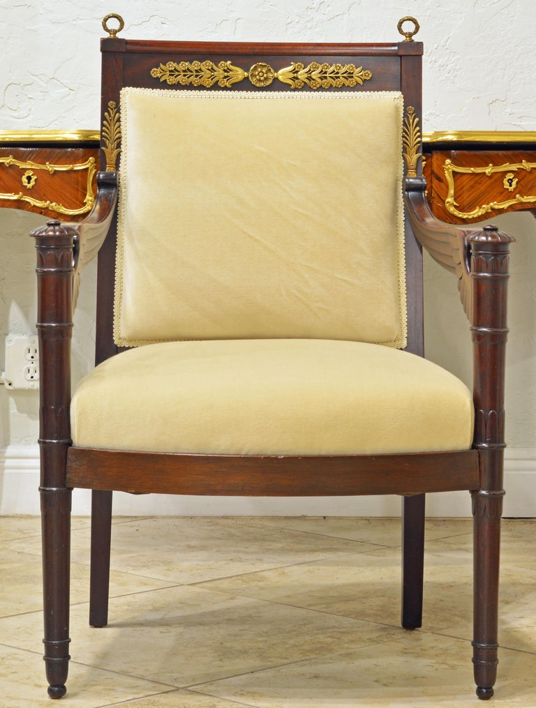 This elegant carved mahogany armchair resting on small casters dates to circa 1870 a time when Napoleon III was Emperor of the French. He adopted many of the stylistic elements first seen during his uncle's Napoleon I reign. The chair features