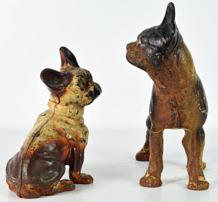 A most fetching sight. The dogs compliment each other well and show a nice overall wear to the color surfaces. Measurements refer to the largest dog. Decorative doorstops weren't widely used in American homes until after the Civil War, and most